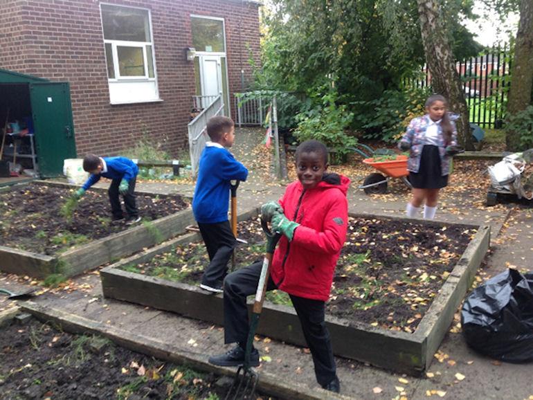 Children working in the school garden